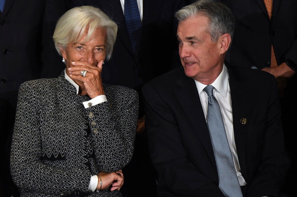 Christine Lagarde, then-director of the International Monetary Fund, speaks with Jerome Powell, the chair of the U.S. Federal Reserve, during the family picture of the G-20 meeting of finance ministers and central bank governors in Buenos Aires on July 21, 2018.
