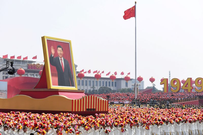 A float with a giant portrait of Chinese President Xi Jinping passes by Tiananmen Square during the National Day parade in Beijing on Oct. 1, 2019.