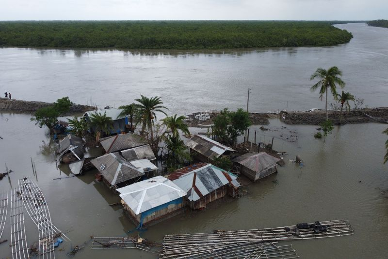 An aerial view shows flooded houses after a dam broke when Cyclone Amphan made landfall in Shyamnagar, Bangladesh, on May 21.