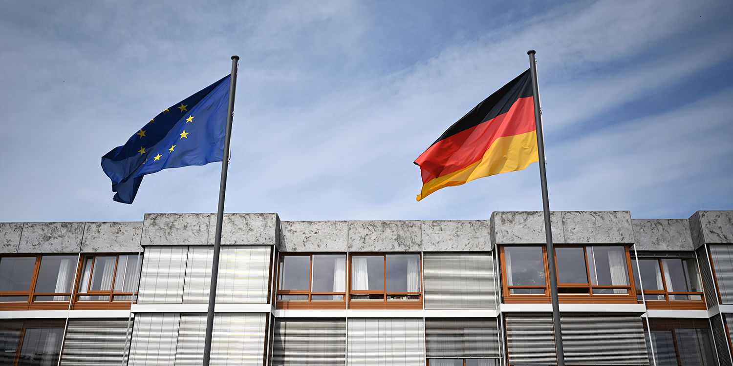 Flags of the European Union and Germany hang in front of the court in Frankfurt on May 5, on the day the Federal Constitutional Court pronounces its judgment on billion-euro purchases of government bonds by the European Central Bank.