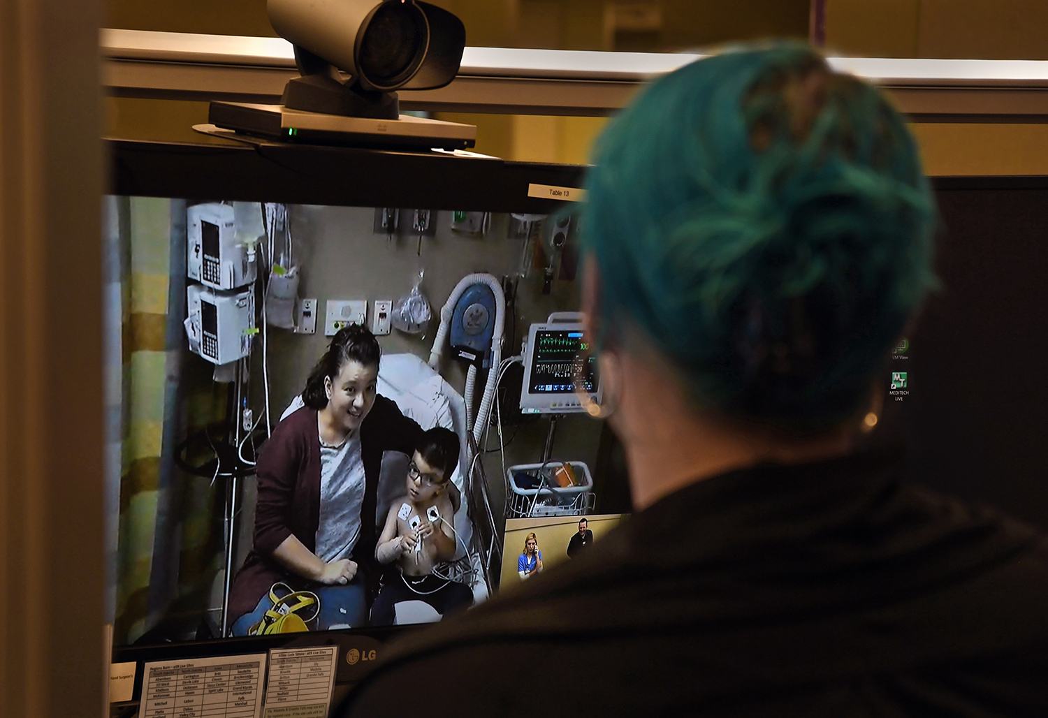 A nurse talks via video from Sioux Falls, South Dakota, with a woman in Abilene, Kansas, hundreds of miles away, who needed a consultation for her 4-year-old son on Oct. 16, 2019.