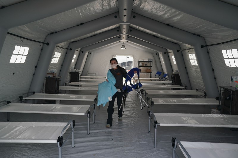 Beds are lined up in a tent as volunteers from the international Christian relief organization Samaritan's Purse set up an emergency field hospital for patients with the coronavirus in Central Park in New York on March 30.