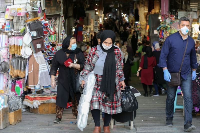 Iranians shop at the Grand Bazaar in Tehran on April 20 as the threat of the COVID-19 pandemic lingers.