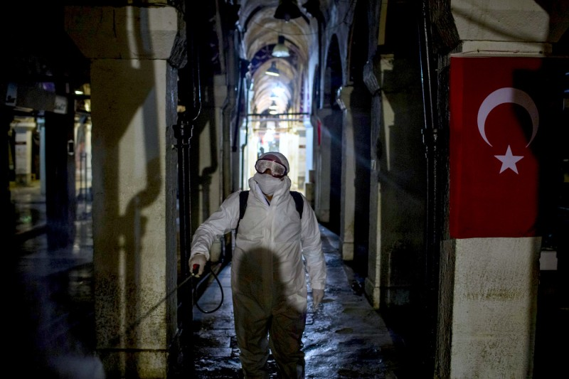 Employees disinfect the streets and shops inside Istanbul's famous Grand Bazaar to prevent the spread of the coronavirus in Istanbul on March 18.