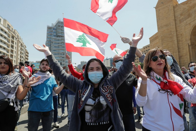 Lebanese anti-government protesters gesture during a demonstration in Beirut against the growing economic crisis on May 1.