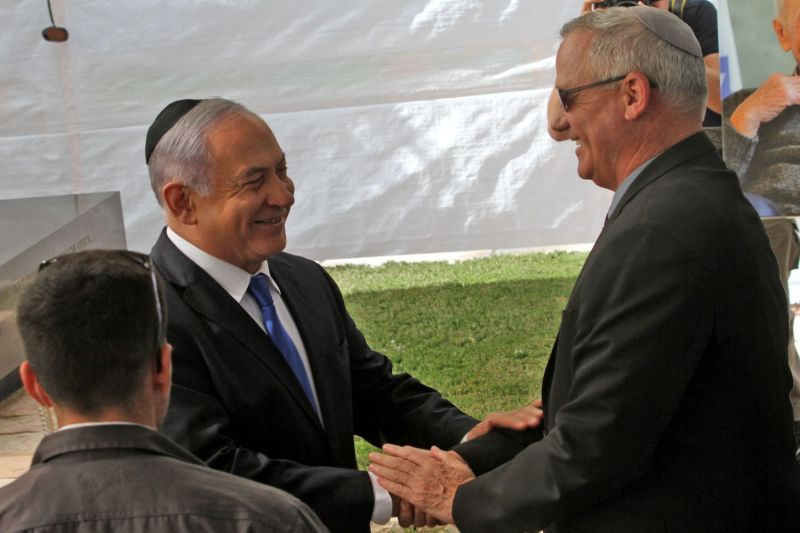 Israeli Prime Minister Benjamin Netanyahu (left) greets Benny Gantz, the leader of Blue and White party, at a memorial ceremony for the late Israeli President Shimon Peres in Jerusalem on Sept. 19, 2019.