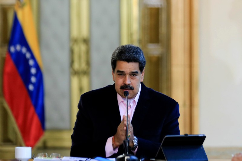 Venezuelan President Nicolas Maduro speaks during a televised announcement in Caracas on March 26.