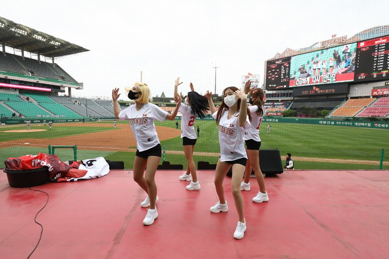 Cheerleaders perform at the opening game of the Korea Baseball Organization League at a crowdless ballpark in Incheon, South Korea, on May 5.