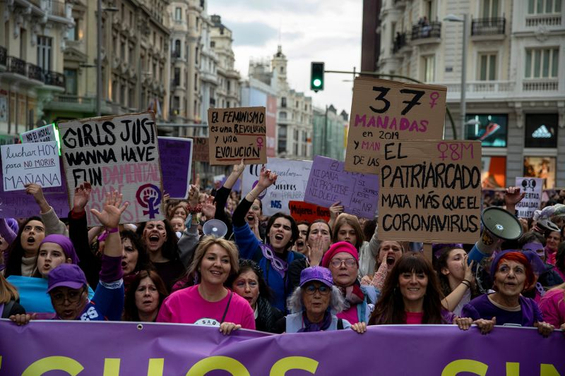 Protesters take part in a march on International Women's Day in Madrid on March 8.