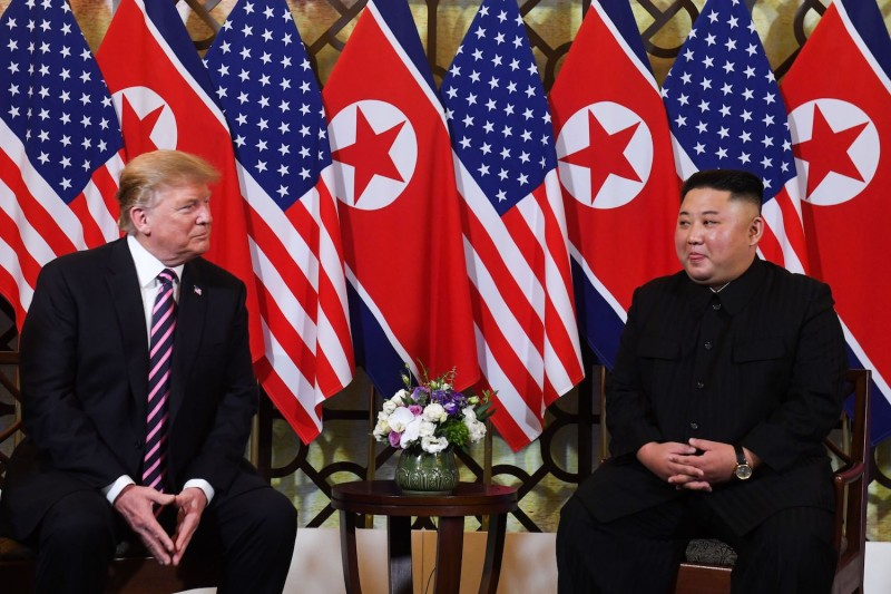 U.S. President Donald Trump listens to North Korean leader Kim Jong Un during a meeting in Hanoi on Feb. 27, 2019.