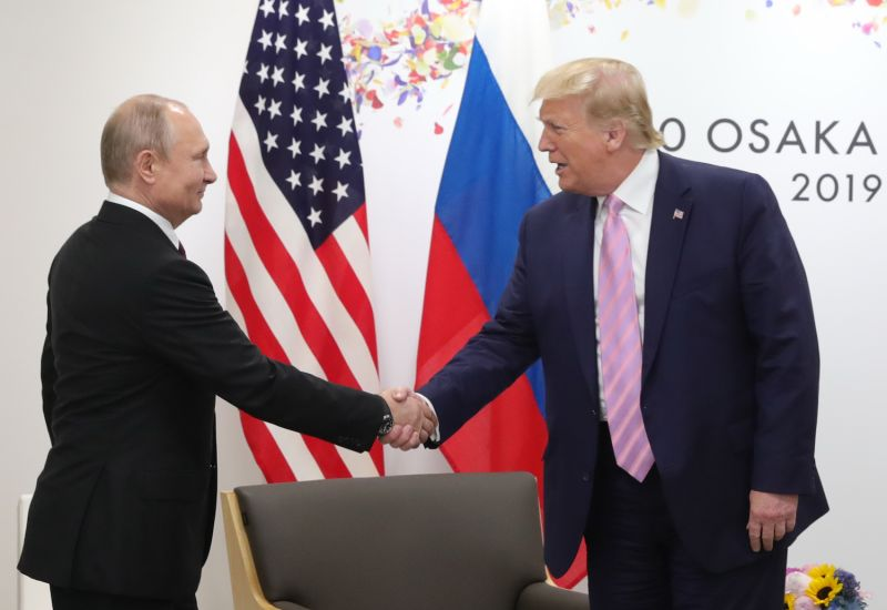 Russian President Vladimir Putin and U.S. President Donald Trump shake hands during the G-20 summit in Osaka, Japan, on June 28, 2019.