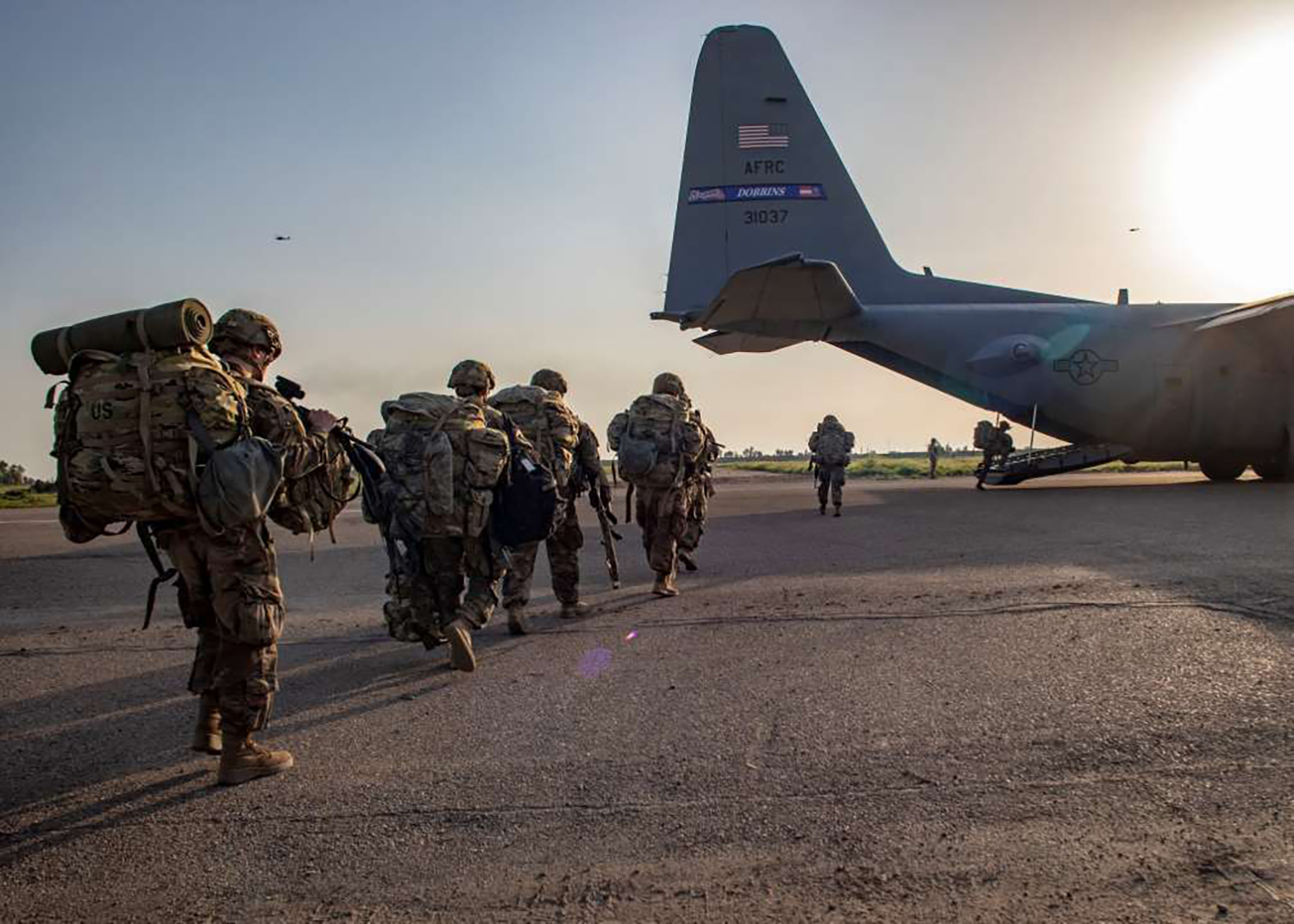 U.S. soldiers board a Lockheed C-130 Hercules at K1 Air Base in northern Iraq on March 24 preparing for the transfer of power to Iraqi forces.