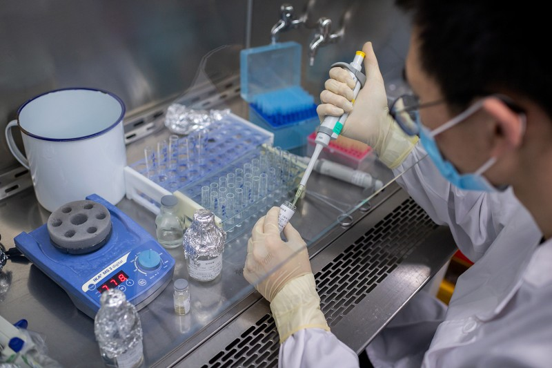 An engineer works  on an experimental coronavirus vaccine at the Sinovac Biotech facilities in Beijing on April 29.