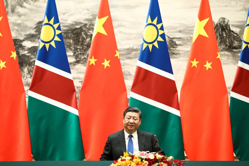 Chinese President Xi Jinping attends a signing ceremony with Namibian President Hage G. Geingob in Beijing on March 29, 2018.