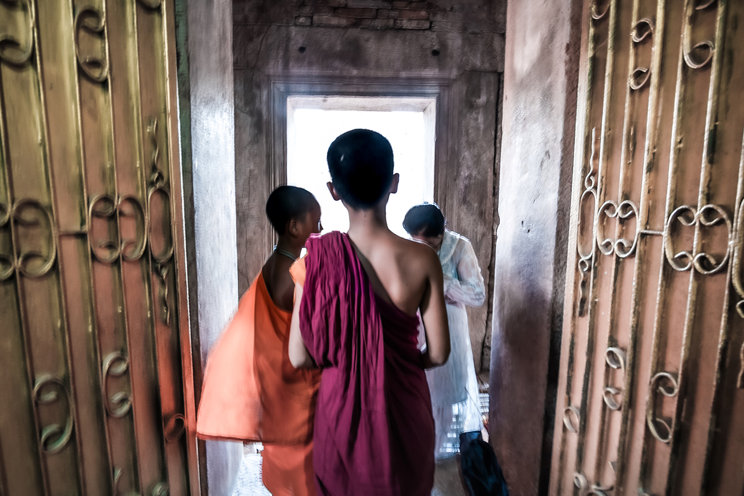 "A family visits a young monk living in a monastery on Phnom Chisor for a blessing on April 5, while another monk looks on. <span class=""attribution""> Jade Sacker for Foreign Policy </span>"