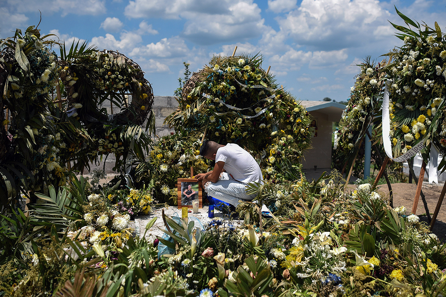 Relatives of 16-year-old Alexander Martinez, a Mexican American killed by police, visit a memorial in the town of Acatlán de Pérez Figueroa in Oaxaca, Mexico, on June 15. The police shooting is under investigation. VICTORIA RAZO/AFP via Getty Images