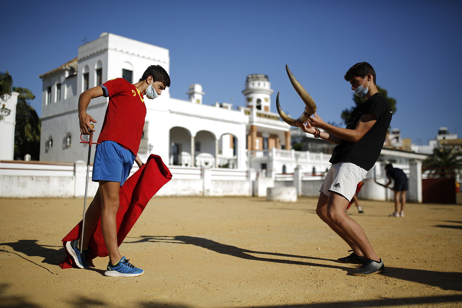 Bullfighting apprentices practice at a school in Seville, Spain, on June 16. Marcelo del Pozo/Getty Images