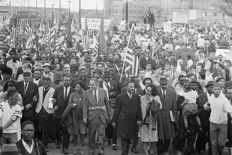 Ralph Bunche (fifth from left in the main row) joins Martin Luther King Jr. on the civil rights march from Selma to Montgomery, Alabama, on March 26, 1965. Bunche, who won a Nobel Peace Prize as the United Nations' Middle East mediator, has been cited as an example of the United Nations' history of fighting discrimination.