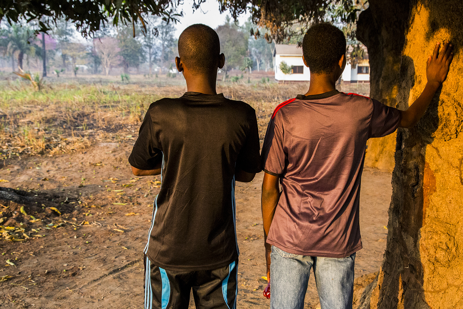 Two teenage boys—who were recruited as child soldiers in 2013 by a mainly Muslim coalition of rebel groups known as Séléka—meet on the outskirts of the rebel-held town of Kaga-Bandoro in northern Central African Republic on Jan. 22, 2018, as part of UNICEF-led efforts to support vulnerable children and train them with new skills.