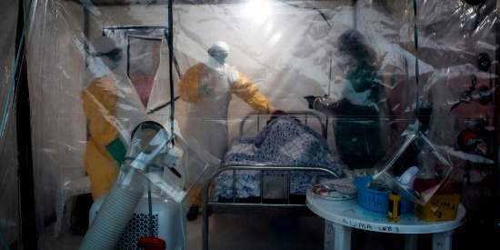 Medical workers check on an Ebola patient in a biosecure emergency care unit in Beni, Democratic Republic of the Congo, on Aug. 15, 2018, after the second Ebola outbreak occurred.