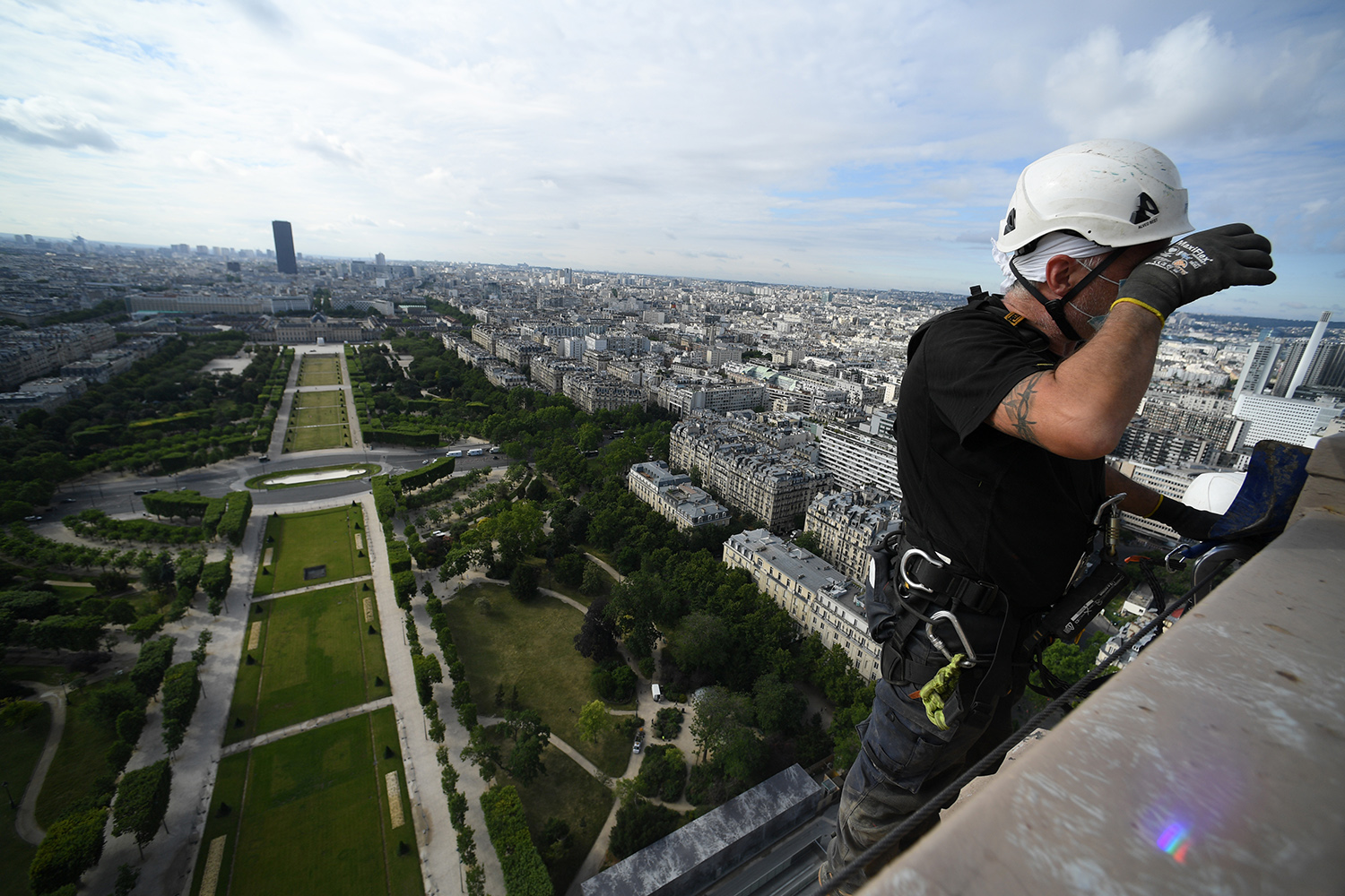 Workers prepare the Eiffel Tower for its reopening in Paris on June 18. Pascal Le Segretain/Getty Images