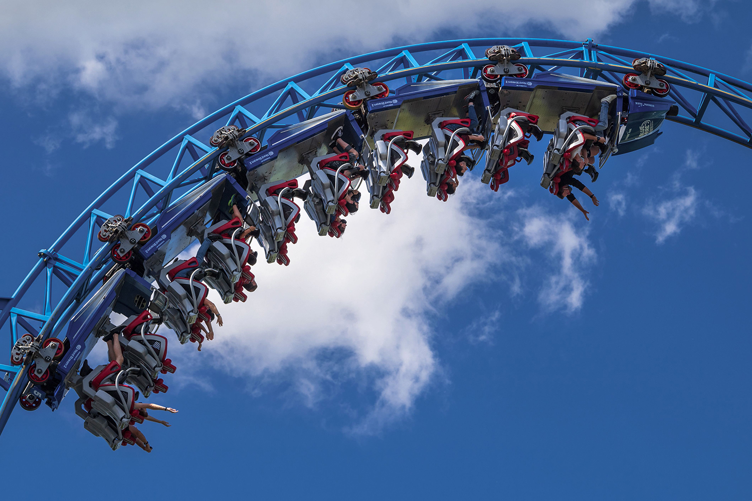 People wearing protective masks ride the Blue Fire roller coaster at Europa-Park in Rust, Germany, on reopening day May 29 following several weeks of lockdown measures. PATRICK HERTZOG/AFP via Getty Images