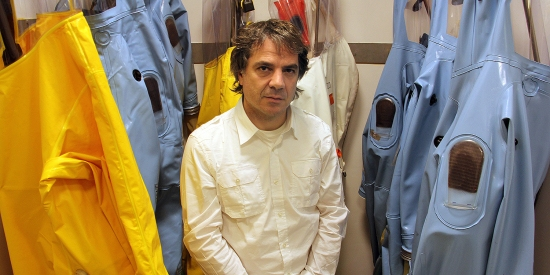 Gary Kobinger, then-chief of special pathogens at the National Microbiology Laboratory in Winnipeg, stands with some of the biosafety suits he wore regularly in 2013.