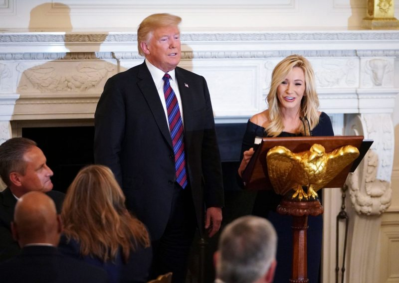 U.S. President Donald Trump is seen with his personal pastor, Paula White, at an event honoring evangelical leadership in the State Dining Room of the White House in Washington on Aug. 27, 2018.