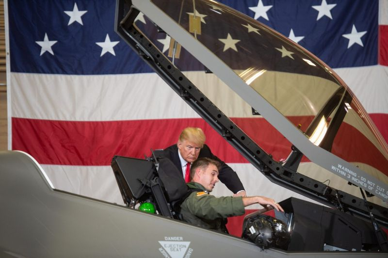 U.S. President Donald Trump speaks with an F-35 fighter plane pilot
