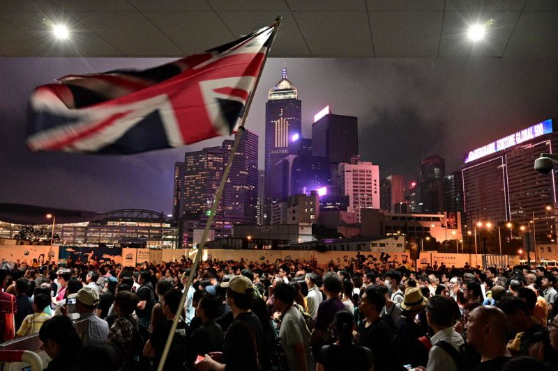 A protester in Hong Kong waves a Union Jack flag