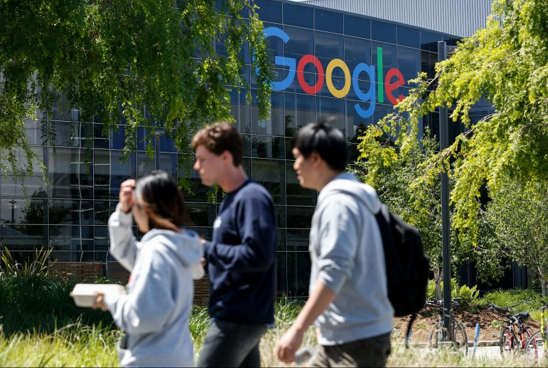 People walk on Google's main campus in Mountain View, California, on May 1, 2019.