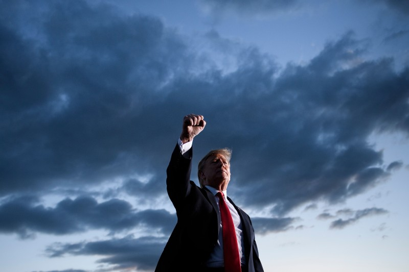 U.S. President Donald Trump holds up his fist as he leaves after speaking during a Make America Great Again rally at Williamsport Regional Airport in Montoursville, Pennsylvania, on May 20, 2019.
