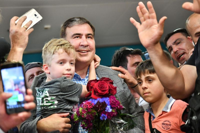Former Georgian President Mikheil Saakashvili is greeted by his supporters after his arriving in Kyiv's Boryspil Airport on May 29, 2019.