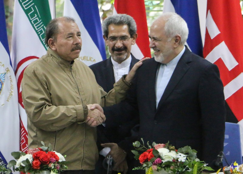 Nicaraguan President Daniel Ortega (left) and Iranian Foreign Minister Mohammad Javad Zarif at a meeting in Managua on July 22, 2019.