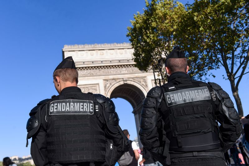 "French gendarmes stand guard in front of the Arc de Triomphe before an anti-government demonstration called by the ""yellow vest"" movement in Paris on Sept. 21."
