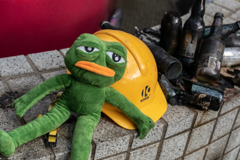 A stuffed doll of Pepe the Frog sits at the main entrance of the Hong Kong Polytechnic University campus in Hong Kong on Nov. 23, 2019.