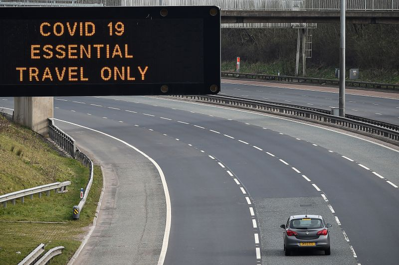 A motorway sign on the M8 motorway advising on essential travel only on March 24 in Glasgow, Scotland.
