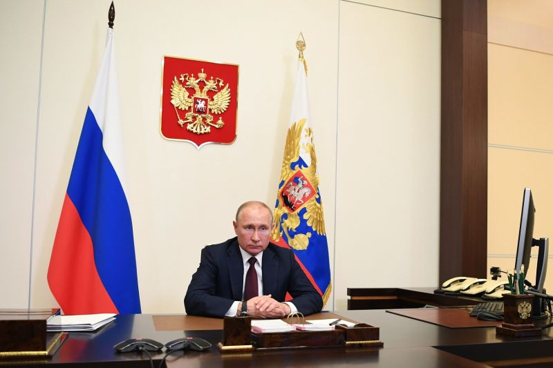 Russian President Vladimir Putin via teleconference call at the Novo-Ogaryovo state residence, outside Moscow on May 26, 2020.