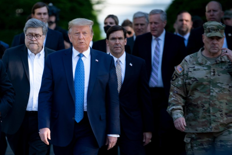 U.S. President Donald Trump walks with Attorney General William Barr, Secretary of Defense Mark Esper, Chairman of the Joint Chiefs of Staff Mark Milley, and others from the White House to visit St. John's Church after the area was cleared of people protesting the death of George Floyd in Washington on June 1.