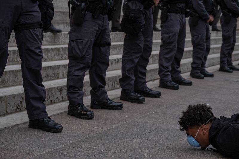 A protester holds a die-in in front of a row of police officers during a peaceful protest over the killing of George Floyd in Columbus, Ohio, on June 1.
