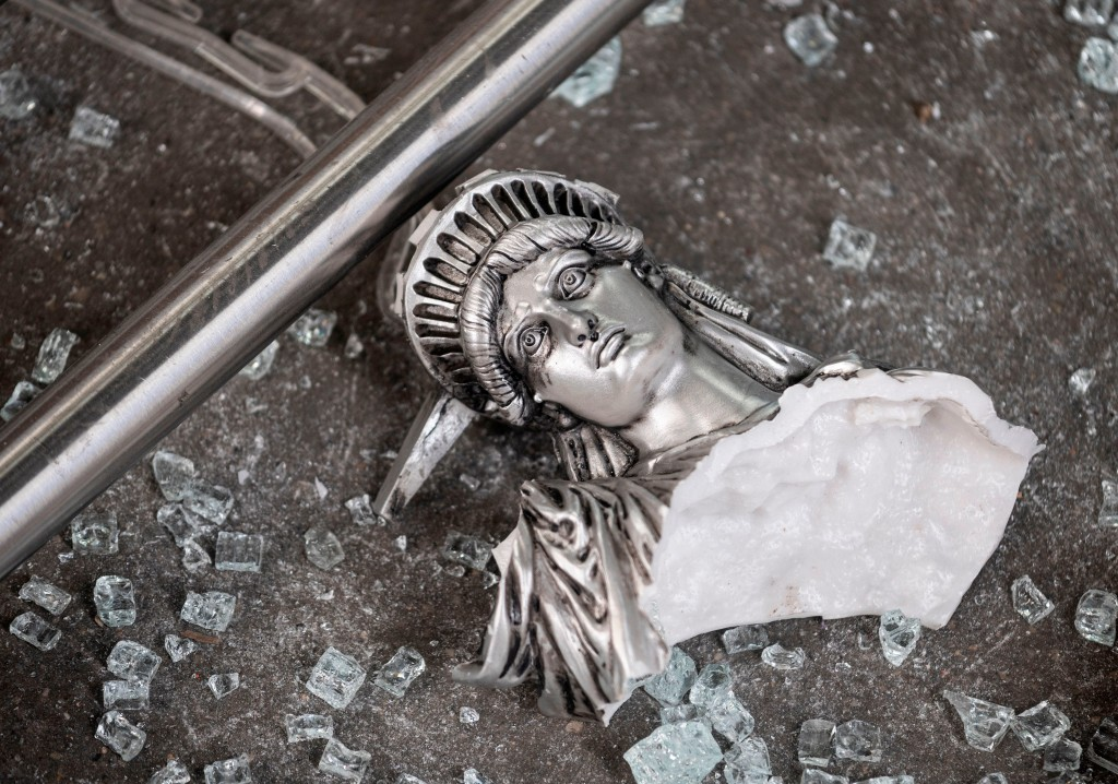 A broken Statue of Liberty figure outside a looted souvenir shop after a night of protest in New York City on June 2.