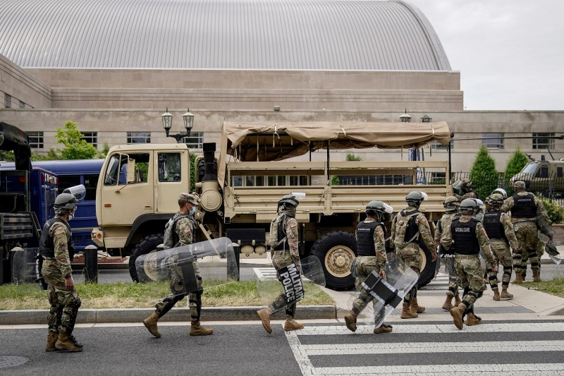 U.S. troops load up into personnel carriers to take them toward Washington, D.C., from the Joint Force Headquarters of the D.C. National Guard on June 2.