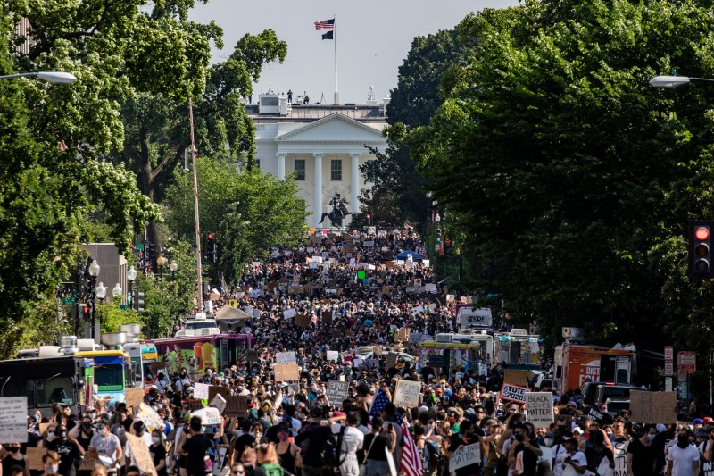 Protesters stretch for more than five blocks, from Scott Circle NW to H Street NW, during demonstrations over the death of George Floyd near the White House on June 6 in Washington.