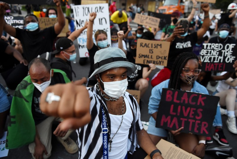 Demonstrators kneel as they protest against police brutality and the death of George Floyd, across from the White House on June 7, 2020 in Washington, DC.