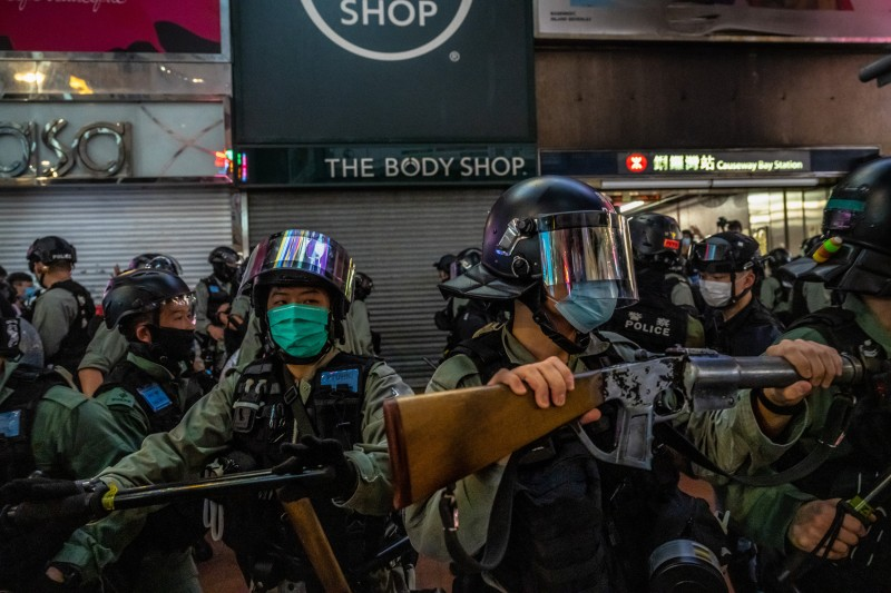Police clear a footpath as protesters gather in Hong Kong