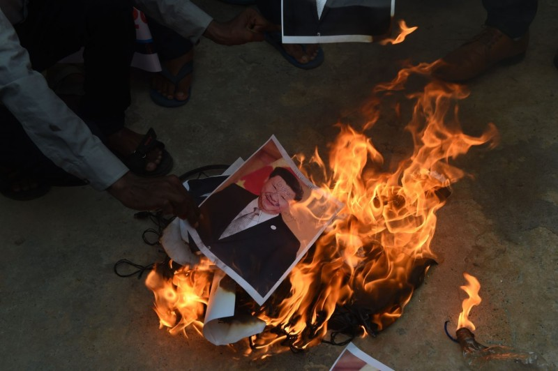 Indian protesters burn a poster of Chinese President Xi Jinping along with Chinese items in response to the killing of Indian soldiers by Chinese troops, in Ahmedabad on June 16, 2020.