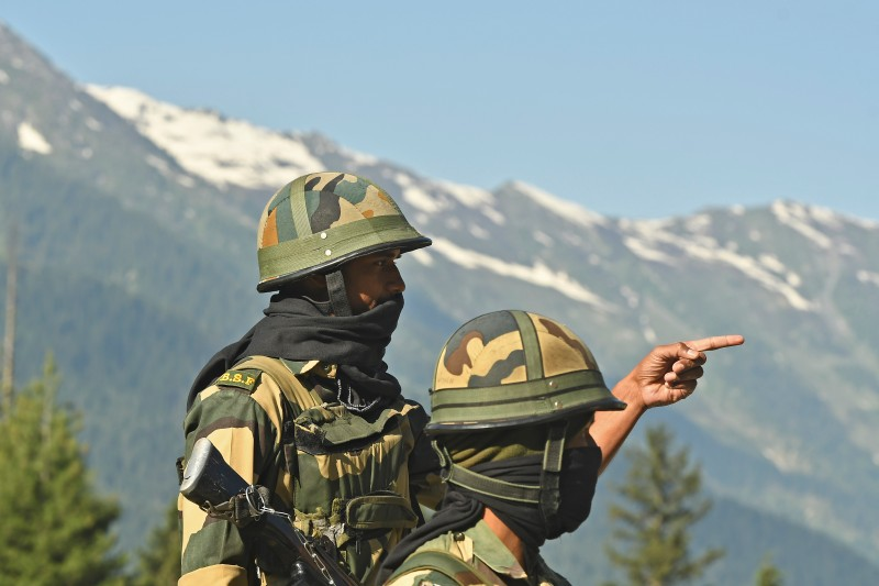Indian Border Security Force soldiers guard a highway leading towards Leh, bordering China, in Gagangir, India, on June 17.