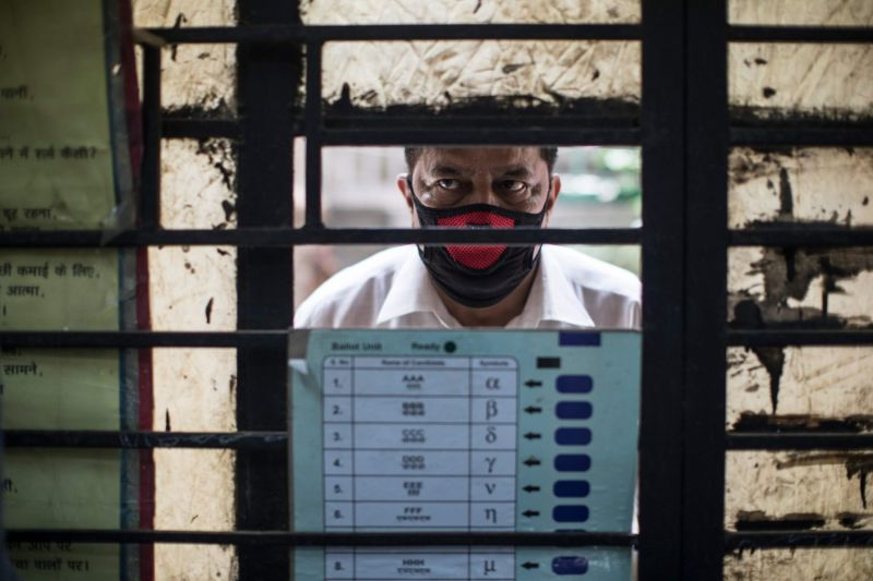 A man waits to be tested for the novel coronavirus in New Delhi