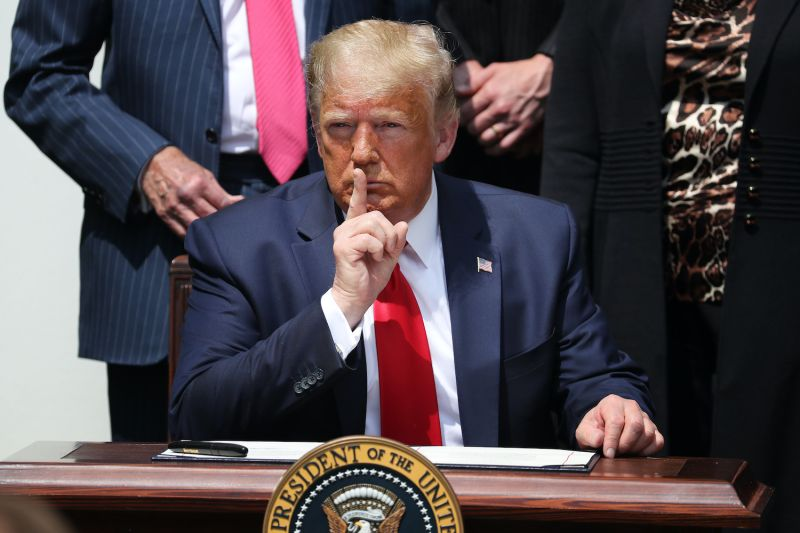 U.S. President Donald Trump shushes journalists before signing the Paycheck Protection Program Flexibility Act in the Rose Garden at the White House June 05, 2020 in Washington, DC.