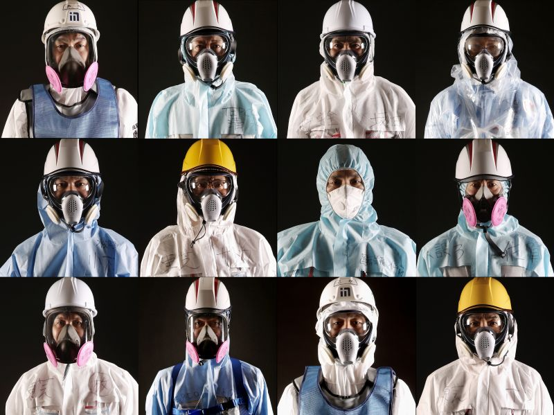 Workers at the Fukushima Daiichi nuclear power plant pose for portraits on Feb. 23, 2016, in Okuma, Japan.